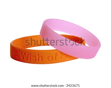 "isolaned orange and pink silicone wristbands, bracelet on the white background ""wish of happiness"""