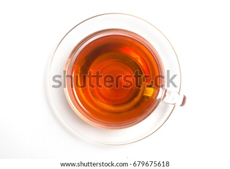Isolate a cup of tea on a saucer from above #679675618