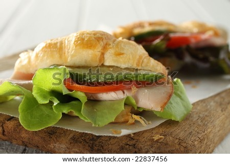 isolate croissant sanwich , fast food for breakfast or lunch.