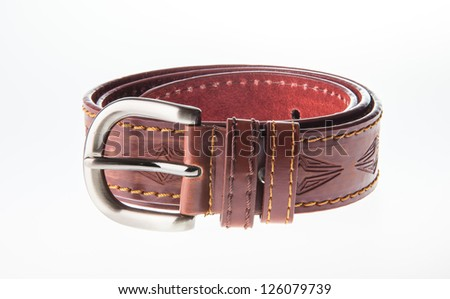 Isolate of brown leather belt against white background