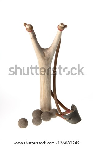 Isolate of wooden slingshot and clay bullets against on white background