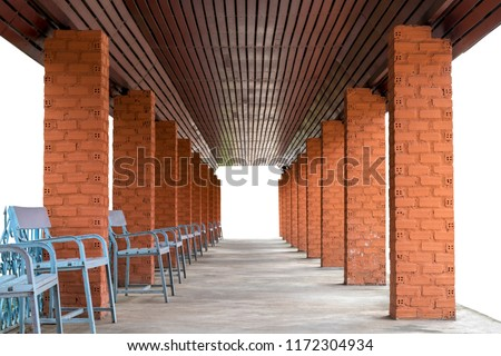 Isolate rows of pillar bricks with benches on concrete floors, which are used as entrances under brown wood ceilings.