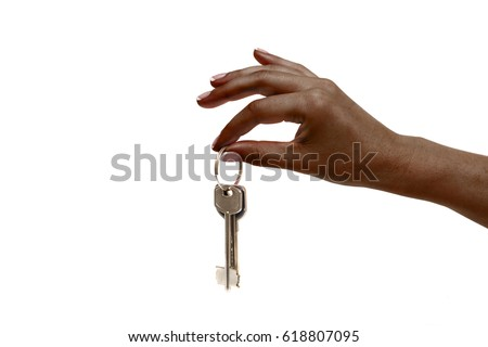 Isolated african female hand holds keys on white background.