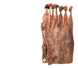 Isolated African Hand Carved Wooden Sculptures of Tribes People with colorful headwear on a white background