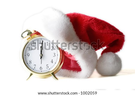 isolated alarm clock with santa hat to show Christmas time