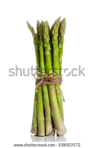 Isolated and standing bunch of asparagus tied with a string in a loop. Refection in the ground.