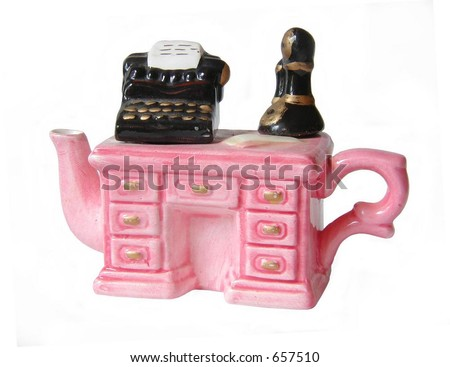 isolated antique tea pot in the shape of desk