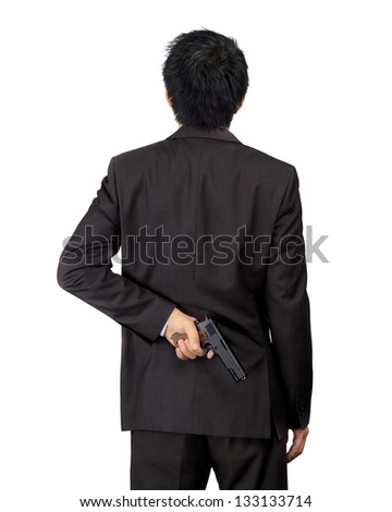 Isolated back of an asian male carry a gun on white