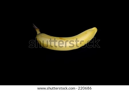 Isolated banana in black background.