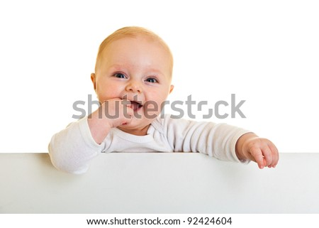Isolated beaufiful caucasian infant baby behind whiteboard