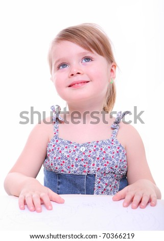 isolated beautiful young girl sitting, imagining and thinking