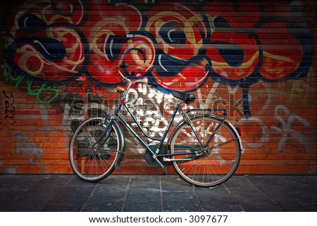 Isolated bike against graffiti background - stock photo