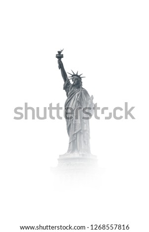 Isolated Black and White Statue of Liberty in New York City NYC. Vintage, Cloudy and fog looking statue of liberty in New York City. Black and White. Great for Website's and Design