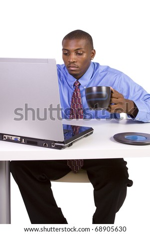 Isolated black Businessman At His Desk Working - White Background - stock photo