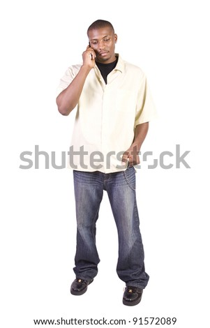 Isolated Black businessman with his hand in pocket talking on the phone