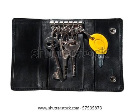 Isolated black leather case for keys  on white background - stock photo