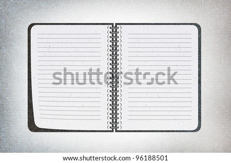 isolated black texture notebook on white,recycled paper craft stick on white background , open notebook on left side.
