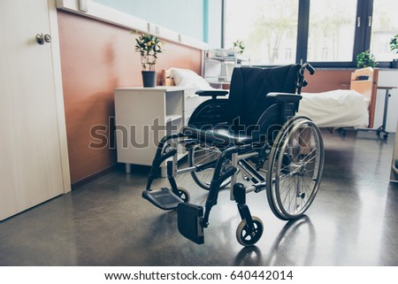 isolated black wheel chair in...