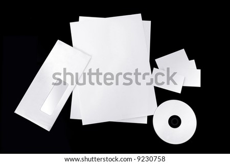 Isolated blank corporate envelope, business cards, pages and cd on black background