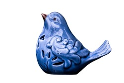 Isolated. Blue bird of happiness. Porcelain or ceramic figurine, toy, statuette, souvenir. Decorative object. Fashionable, trendy color 2020 Classic Blue or Phantom Blue.