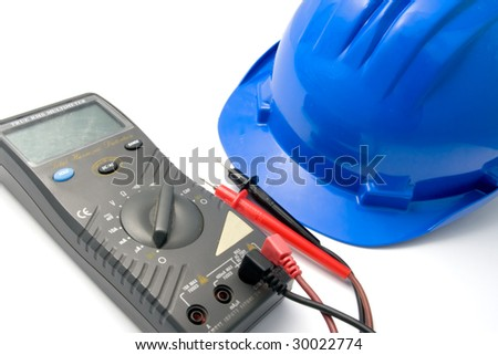 Isolated blue helmet and multimeter for workers