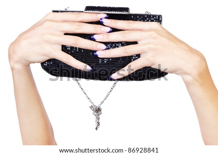 isolated body part shot of beautiful young woman's manicured hands with fancy clutch on white