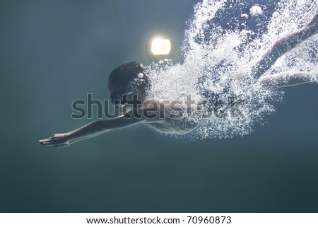 isolated Boy after jump underwater - stock photo