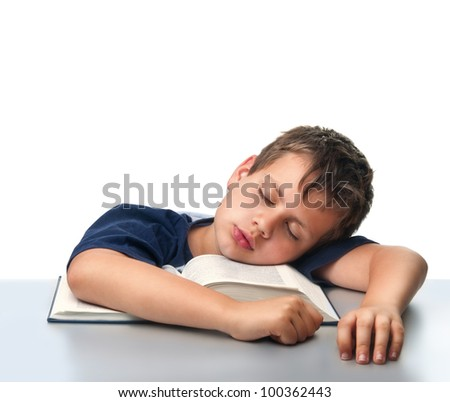 isolated boy dreaming over thick book