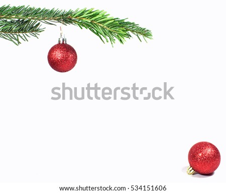 isolated branch of a Christmas tree with two red glitter baubles  #534151606