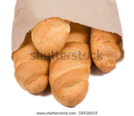 isolated bread in paper packet on white - stock photo