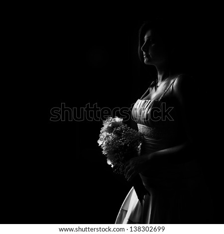 Isolated bride on black background with white dress