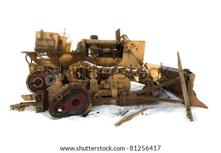 Isolated broken bulldozer on snow.