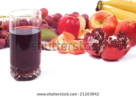 isolated broken pomegranate on some parts pomegranate fruit and juice