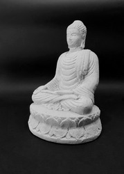 Isolated Buddha statue, black background. Symbol of the Buddhist religion. Space to add text