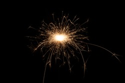 Isolated burning sparkler, fireworks for holidays includes christmas, happy new year