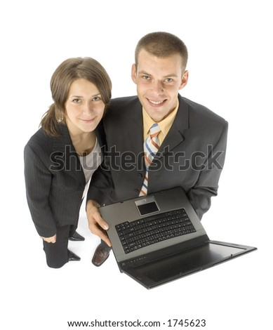 isolated business couple with laptop - stock photo