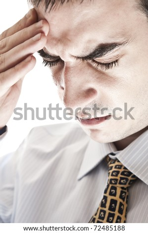 Isolated business man expressing headache
