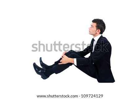Isolated business man sitting down and looking up