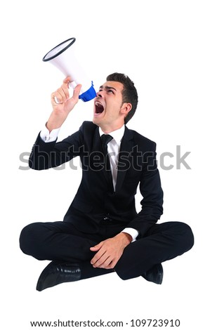 Isolated business man sitting loudspeaker