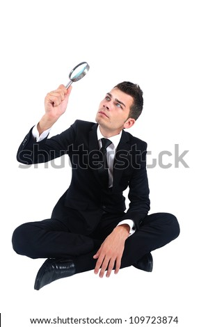 Isolated business man with magnifying glass