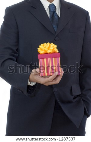 Isolated businessman carrying a gift