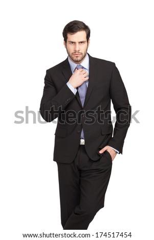isolated businessman fixing his tie - stock photo