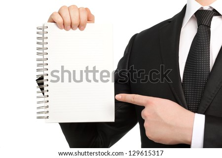 Isolated businessman in a suit and tie holding a notebook or piece of paper