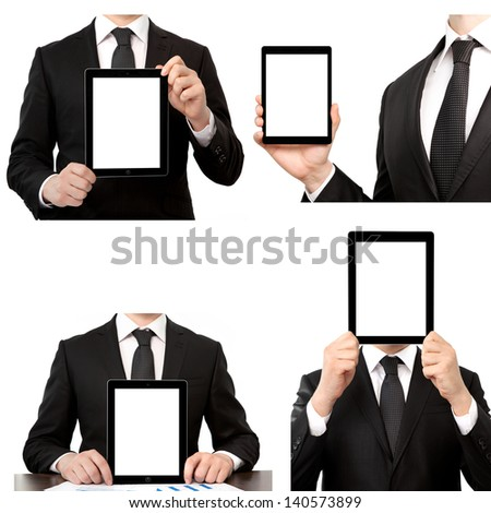 Isolated businessman in a suit holding a touch tablet computer