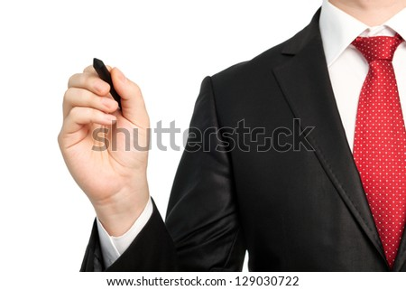 Isolated businessman in a suit with a red tie holding a pen and writing something