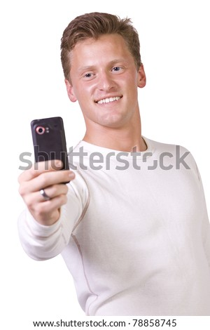 Isolated businessman sending a picture message on his cell phone