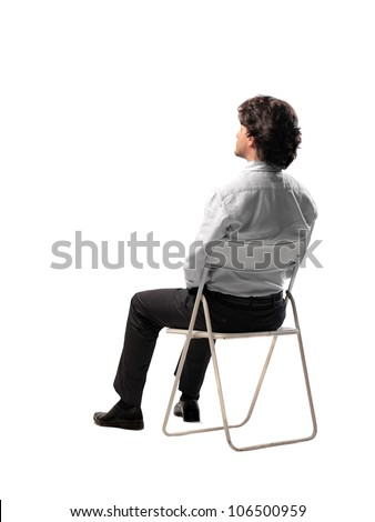 Isolated businessman sitting on a chair