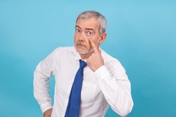 isolated businessman with distrustful expression