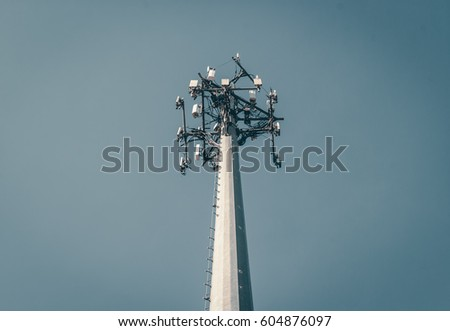 Shutterstock Isolated cellular radio antenna. Radio antenna with clear sky background. Industrial energy power design. Minimal design and detail. Broadcast tower. Steel beam tower.