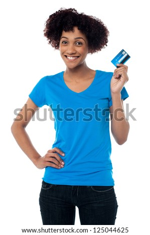 Isolated cheerful woman showing cash card. It's shopping time.